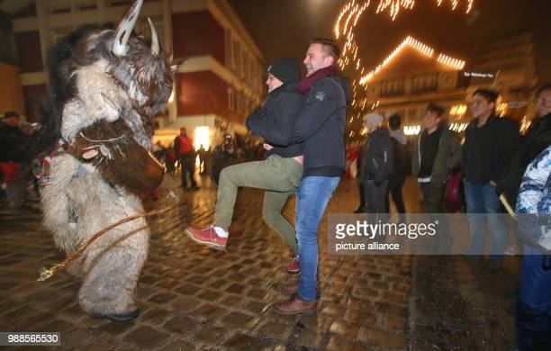 """So-called """"Klausen"""" can be seen in the inner city of Sonthofen, Germany, 05 December 2017. The custom sees young men dress up with masks and furs,..."""