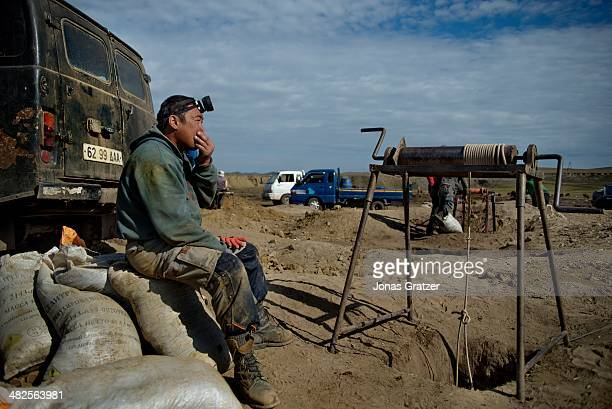 """So-called """"ninja"""" in the Sharyngol district of Mongolia takes a break after working heavily underground for the past couple of hours. Mongolia today..."""