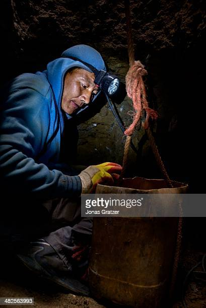 """So-called """"ninja"""" in the Sharyngol district of Mongolia uses a bucket and rope system to move the rocks from underground to the surface above...."""