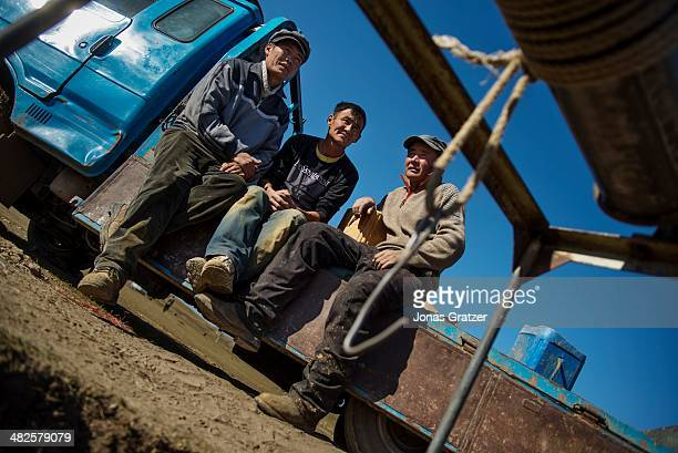 """So-called """"ninjas"""" in the Sharyngol district of Mongolia take a break after heavy work underground for the past couple of hours. Mongolia today is..."""