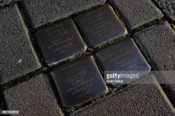 """So-called """"Stolpersteine"""", literally translated as """"stumbling stones,"""" lie in silent testimony in the sidewalk in front of the location where members..."""