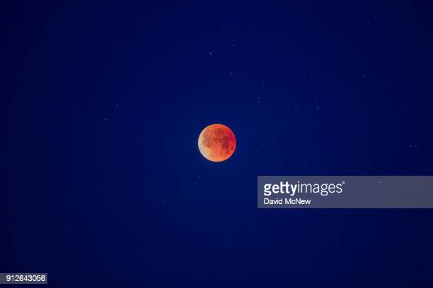 A socalled 'super blue blood moon' is seen in total eclipse above the Mojave Desert on January 31 2018 near Amboy California The 'Super Blue Blood...