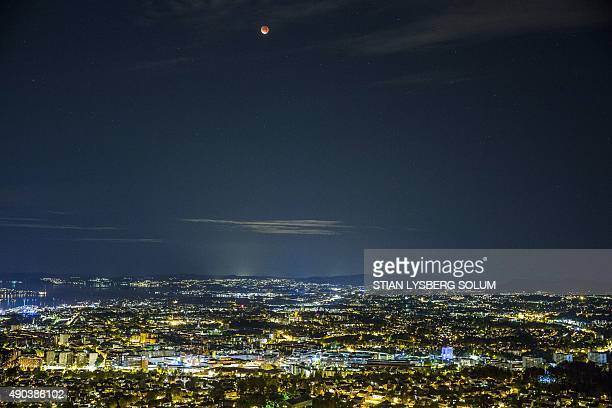 A socalled 'super moon' hangs in the sky over Oslo during a total lunar eclipse on September 28 2015 Skygazers were treated to a rare astronomical...