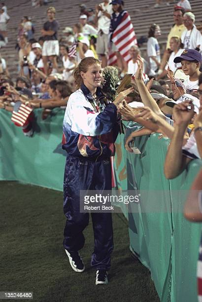 1996 Summer Olympics USA Cindy Parlow victorious with fans after Women's Final gold medal ceremony following win over China at Sanford Stadium Athens...