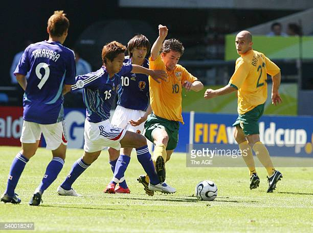 Soccer 2006 Australia's Harry Kewell is under pressure during the World Cup match between Australia and Japan in Kaiserslautern 12 June 2006 THE AGE...