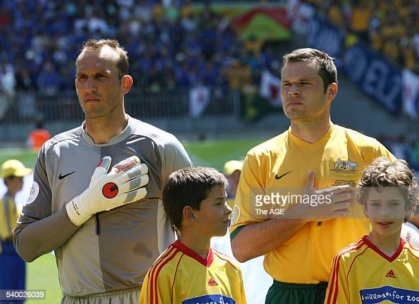 Soccer 2006 Australia's Mark Schwarzer and Mark Viduka put their hands on their hearts during the singing of the Australian national anthem before...