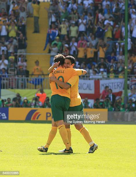 Soccer 2006 Australia's Tim Cahill is congratulated by Harry Kewell after scoring his first goal during the World Cup match between Australia and...