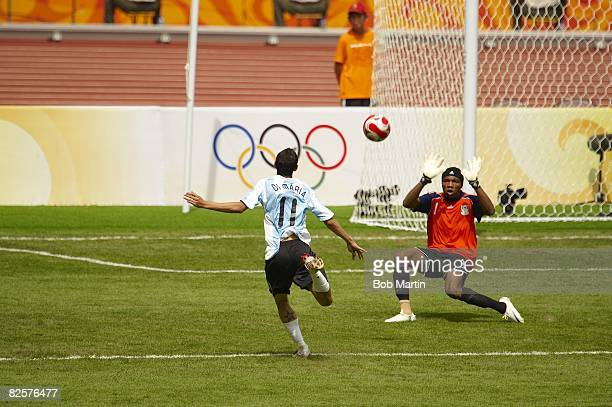 2008 Summer Olympics Argentina Angel Di Maria in action chipping gamewinning goal vs Nigeria Ambruse Vanzekin during Men's Gold Medal Match at...