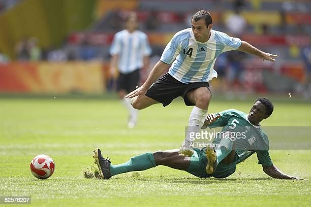 2008 Summer Olympics Argentina Javier Mascherano in action vs Nigeria Dele Adeleye during Men's Gold Medal Match at National Stadium Argentina won 10...