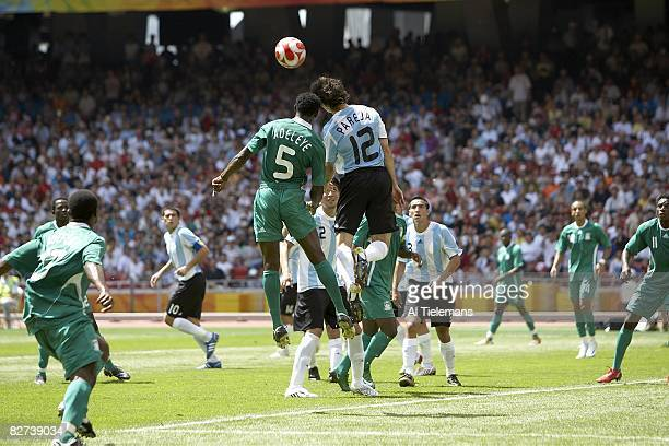 2008 Summer Olympics Argentina Nicolas Pareja in action vs Nigeria Dele Adeleye during Men's Gold Medal Match at National Stadium Argentina won 10...