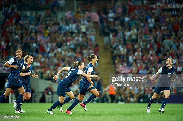 2012 Summer Olympics USA Carli Lloyd victorious with Kelley O'Hara and Rachel Buehler after scoring goal vs Japan during Women's Gold Medal Match at...