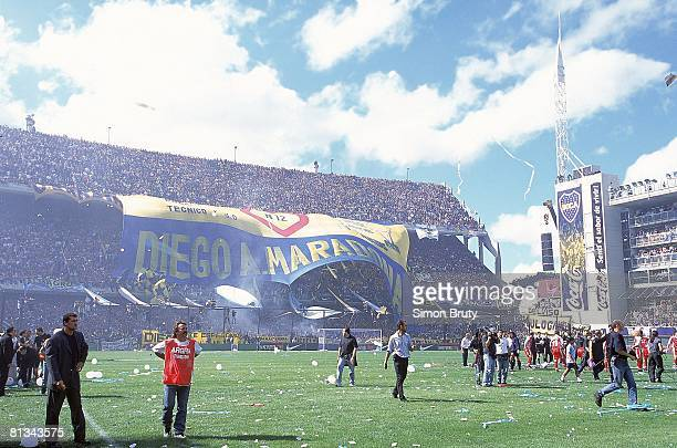Soccer ARG fans with Diego Maradona sign at stadium during game vs PER Buenos Aires ARG 11/6/2001