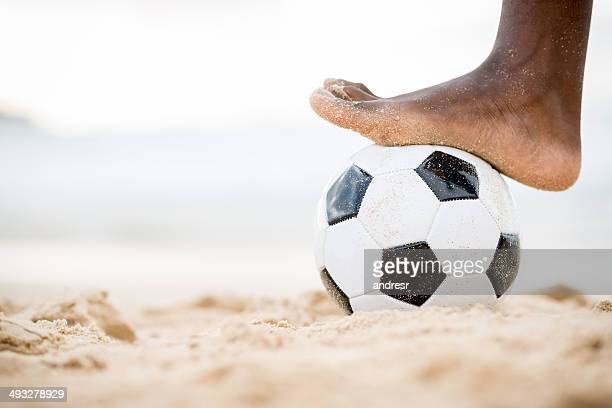 soccer at the beach - male feet stock photos and pictures