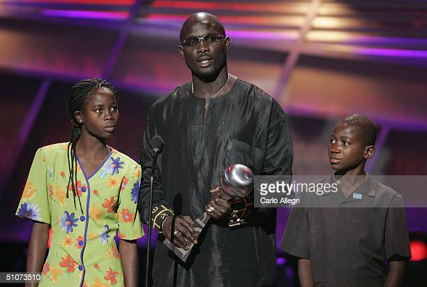 Soccer athlete George Weah and guests speak on stage at the 12th Annual ESPY Awards held at the Kodak Theatre on July 14 2004 in Hollywood California...