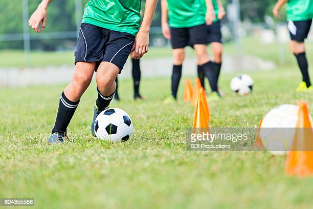 soccer athlete participates in soccer practice drills - practicing stock pictures, royalty-free photos & images