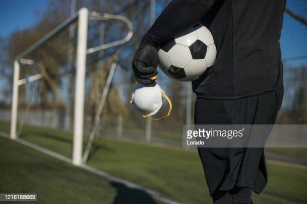 soccer ball and virus mask - football face mask stock pictures, royalty-free photos & images