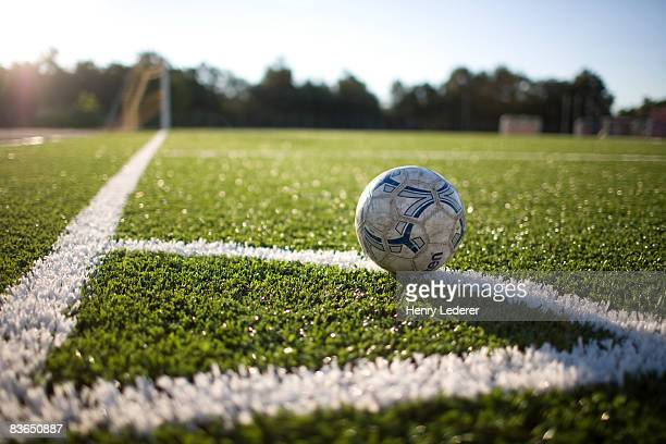 soccer ball at corner marker of soccer field - sports field stock pictures, royalty-free photos & images