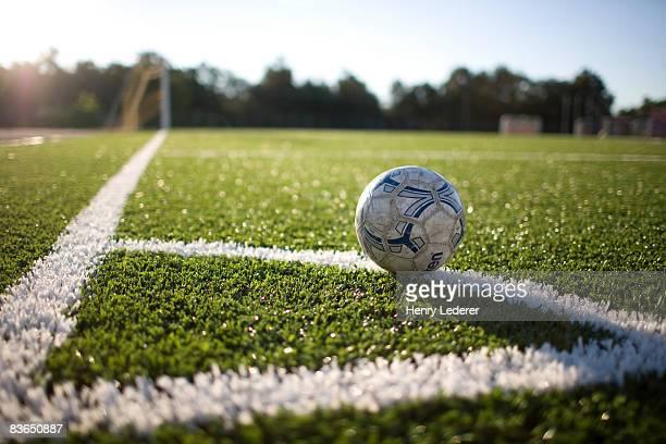 soccer ball at corner marker of soccer field - campo de futebol imagens e fotografias de stock