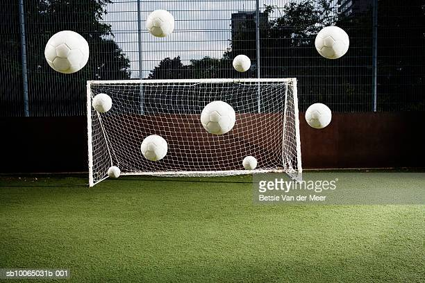 soccer ball entering soccer net - shooting at goal stock pictures, royalty-free photos & images