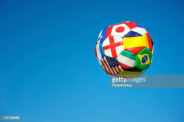Soccer Ball Football with Flags of Many Countries Blue Sky
