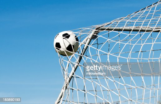 The Soccer Ball Hit Into The Net: Soccer Ball Hits The Net And Makes A Goal High-Res Stock