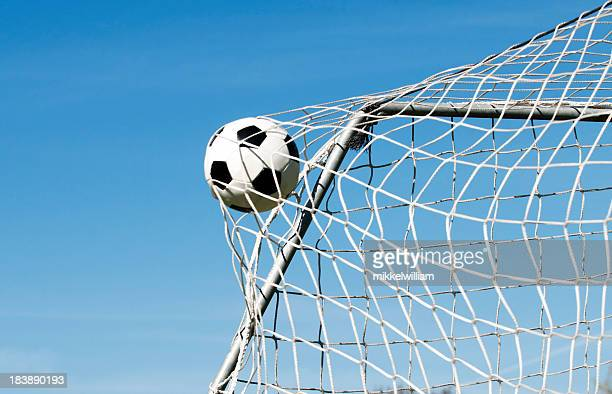 soccer ball hits the net and makes a goal - shooting at goal stock pictures, royalty-free photos & images