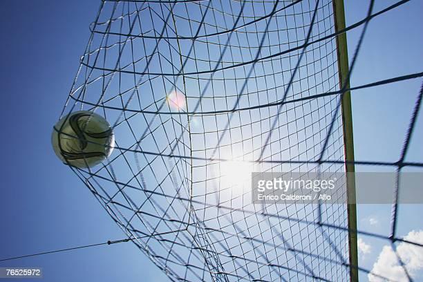 Soccer ball hitting back of net