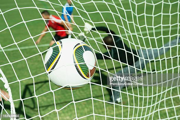 soccer ball hitting goal net - soccer goal stock pictures, royalty-free photos & images