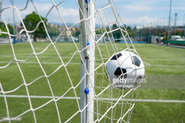 soccer ball hitting net against sky - sports venue stock pictures, royalty-free photos & images