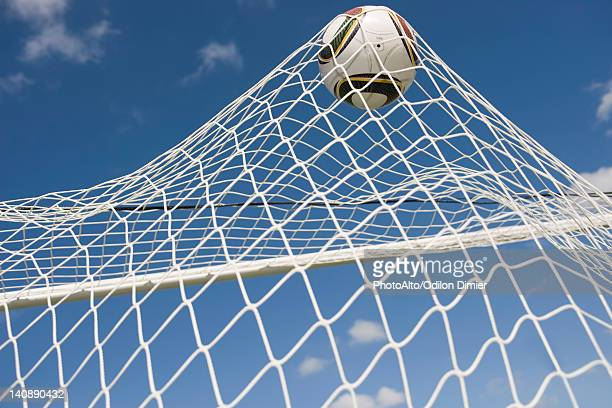 soccer ball hitting net - netting stock pictures, royalty-free photos & images