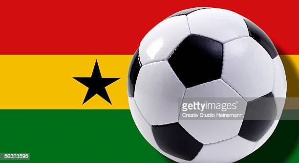 soccer ball in front of ghana flag, close-up - ghanaian flag stock photos and pictures