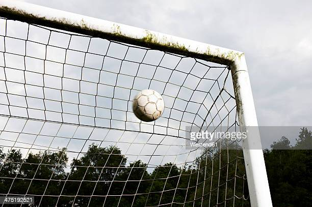 soccer ball in goal - point scoring stock pictures, royalty-free photos & images