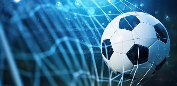 Soccer ball in goal 700692228