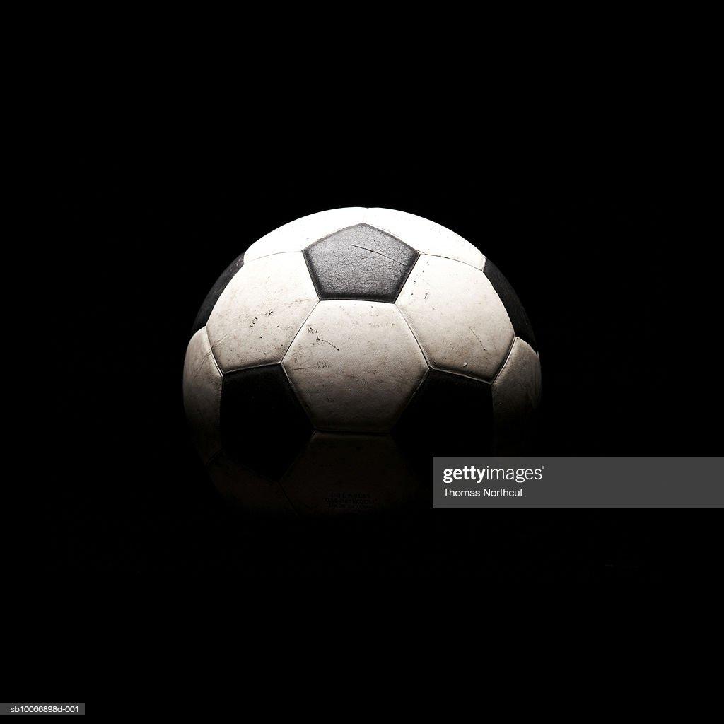 Soccer ball in shadows : Stock Photo