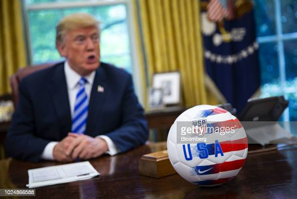A USA soccer ball is placed on the Resolute Desk as US President Donald Trump speaks during a meeting with Gianni Infantino president of FIFA not...