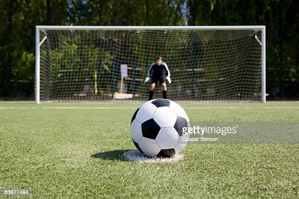 a soccer ball on a soccer field - goalkeeper stock pictures, royalty-free photos & images