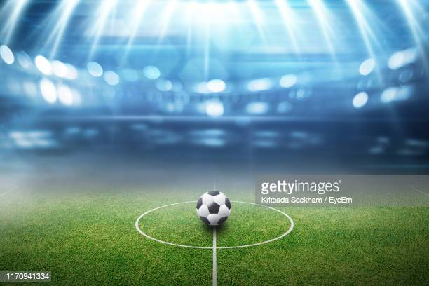 soccer ball on field in stadium - stadium lights stock pictures, royalty-free photos & images