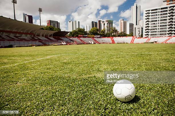 Soccer ball on field in stadium