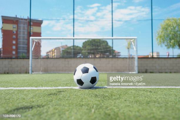 soccer ball on field - soccer goal stock pictures, royalty-free photos & images