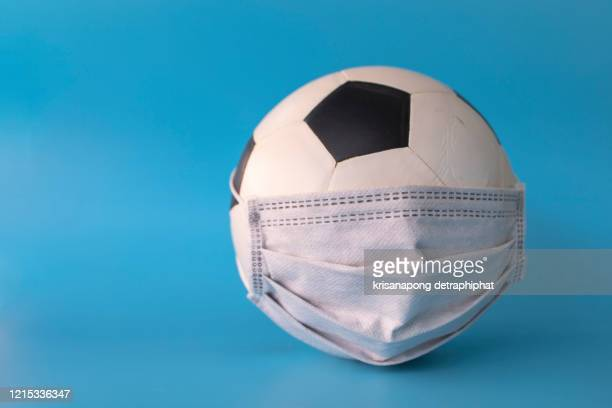 soccer ball with mask,mask,covid-19,coronavirus,the concept of not playing football, - face guard sport stock pictures, royalty-free photos & images