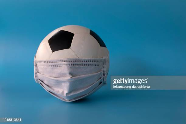 soccer ball with mask,mask,covid-19,coronavirus,the concept of not playing football - international team soccer stock pictures, royalty-free photos & images