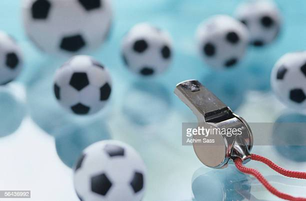 Soccer balls and whistle