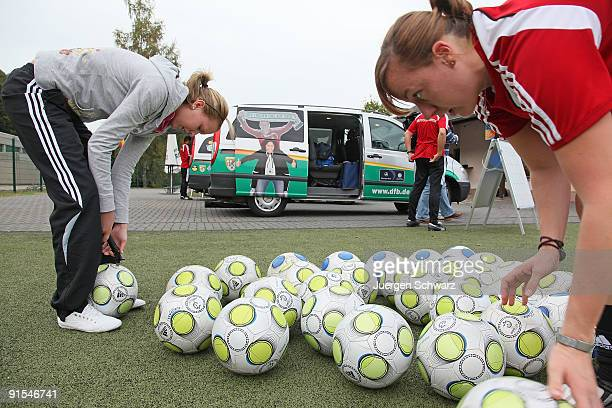 Soccer balls are prepared in front of DFB mobil vans at the Tawern soccer club stadium on October 7 2009 in Tawern Germany