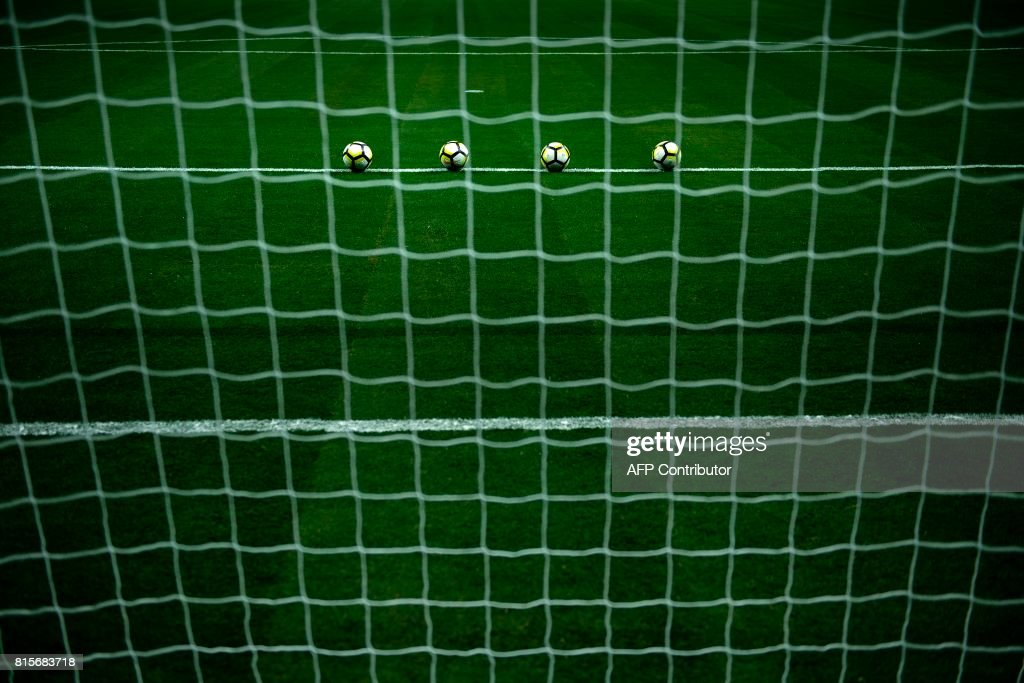 Soccer balls are seen before warmups for the Jamaica vs. El Salvator CONCACAF Gold Cup match at the Alamodome on July 16, 2017 in San Antonio, Texas. / AFP PHOTO / Brendan Smialowski