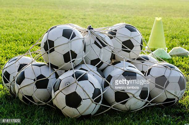 soccer balls in the net - netting stock pictures, royalty-free photos & images