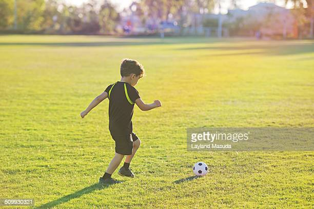 Soccer Boy In Sunlight