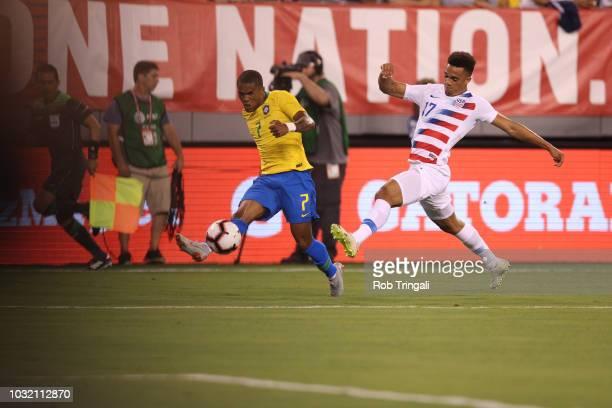 Brazil Douglas Costa in action vs USA Antonee Robinson during Men's International Friendly at MetLife Stadium East Rutherford NJ CREDIT Rob Tringali