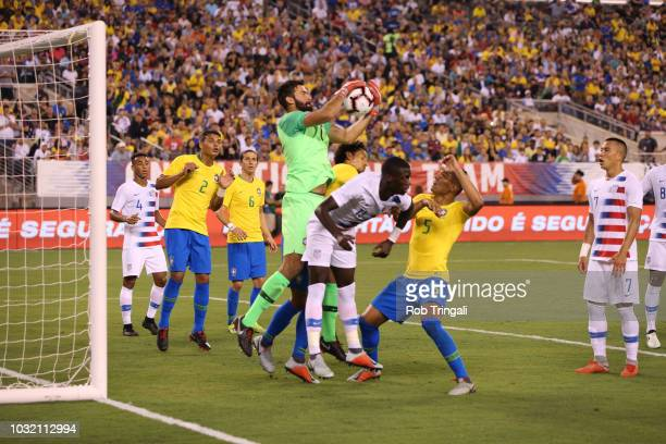 Brazil goalie Alisson in action making save vs USA during Men's International Friendly at MetLife Stadium East Rutherford NJ CREDIT Rob Tringali