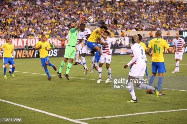 Brazil goalie Alisson in action punching away ball vs USA during Men's International Friendly at MetLife Stadium East Rutherford NJ CREDIT Rob...