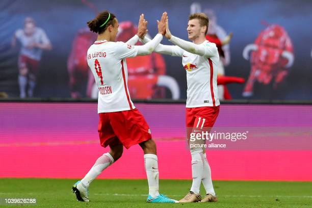 Bundesliga RB Leipzig SC Freiburg 29th Gameday at the Red Bull Arena Leipzig Germany 15 April 2017 Leipzig's Yussuf Poulsen and Timo Werner celebrate...
